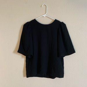 H&M black blouse w/ zipper on the back